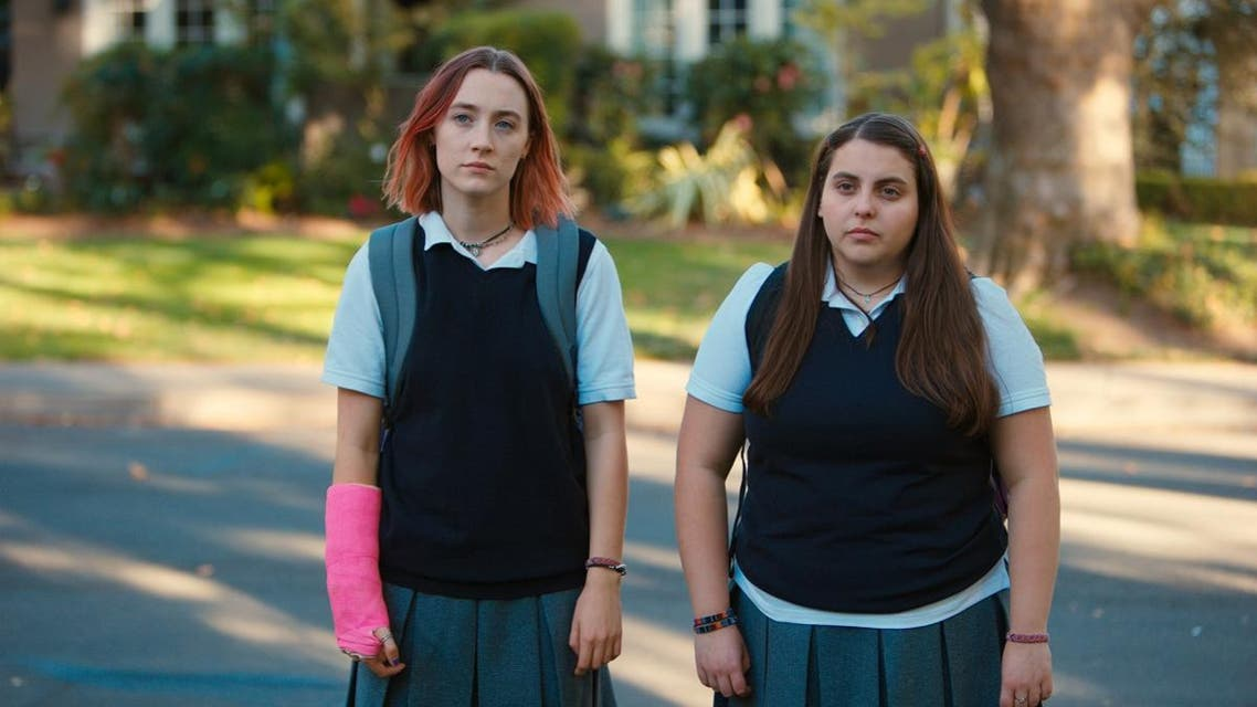 "This file image released by A24 Films shows Saoirse Ronan, left, and Beanie Feldstein in a scene from ""Lady Bird."" (Merie Wallace/A24 via AP)"