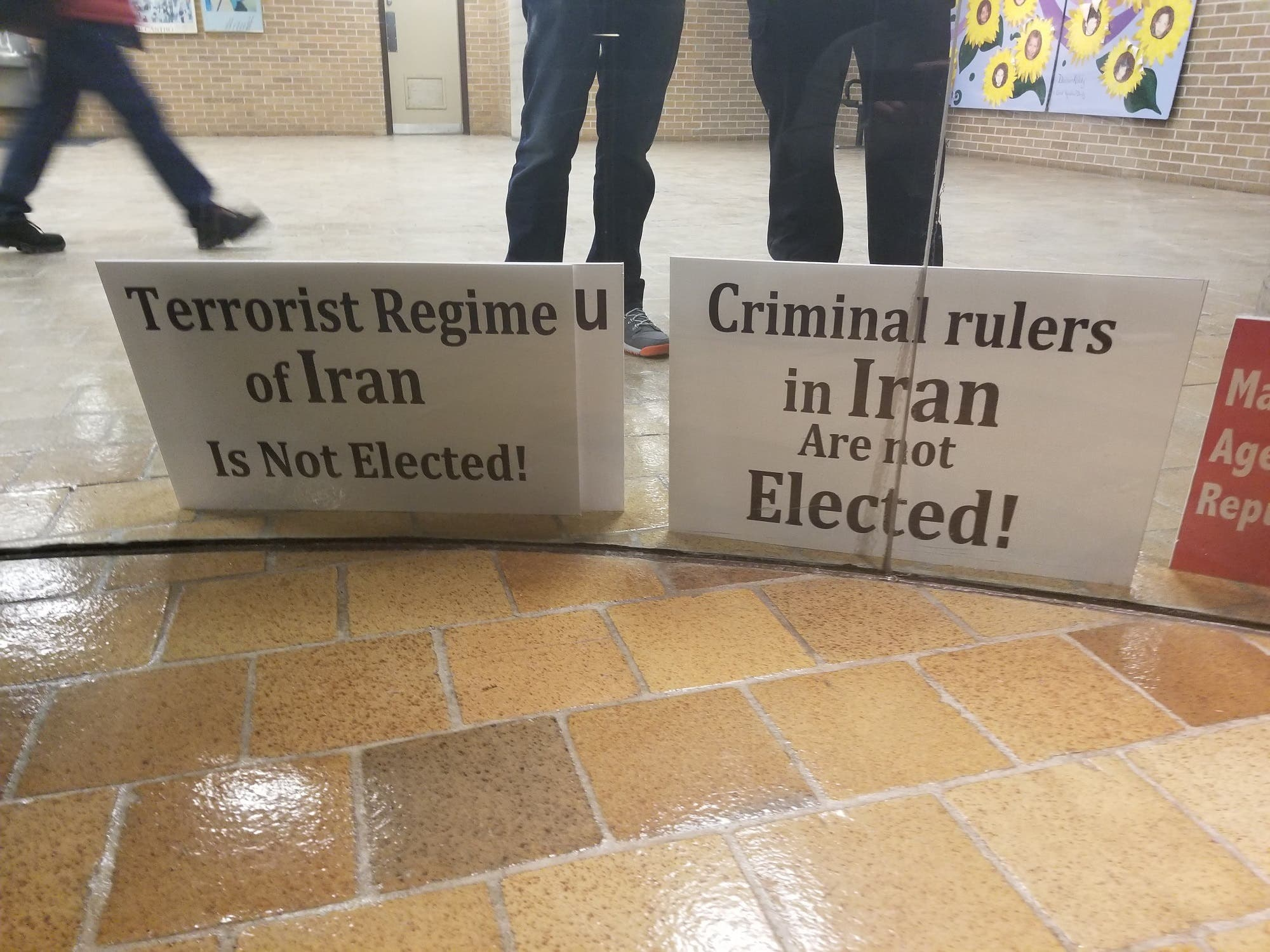 Placards seen at the rally in North York Civic Centre on Jan. 7, 2018. (Picture by Dina Al-Shibeeb)