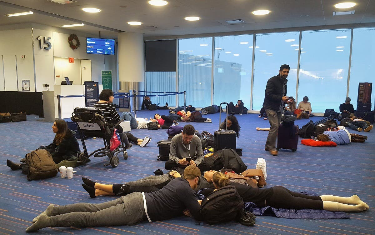 Passengers wait for their delayed flights at gate 15 in terminal five at John F. Kennedy International Airport. (AFP)