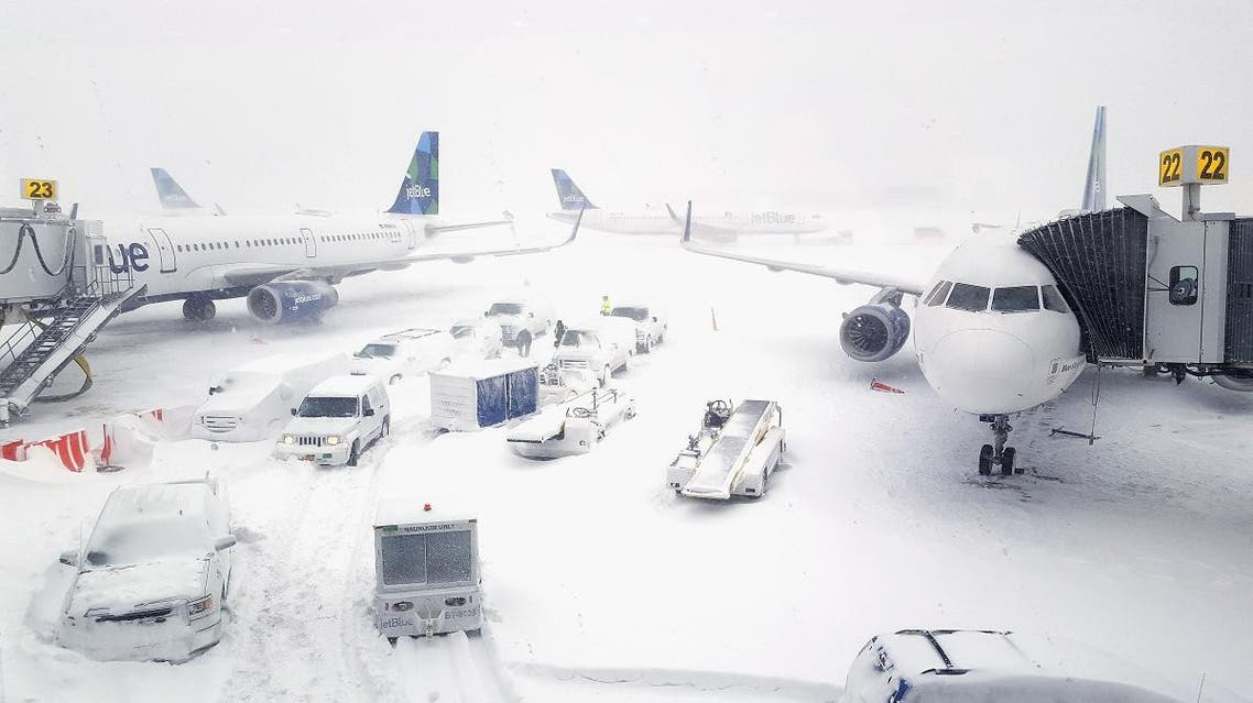 JetBlue airplanes wait at the gates outside terminal five at John F. Kennedy International Airport. (AFP)