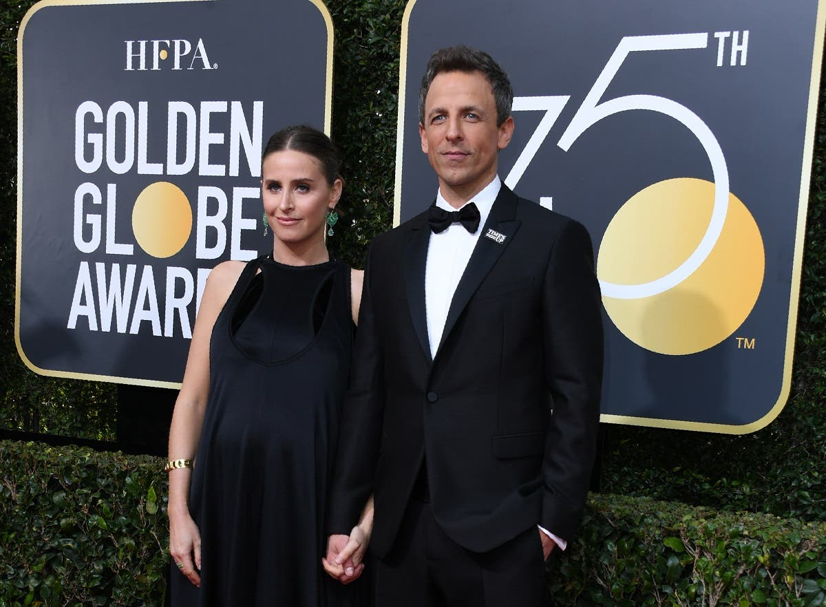 Seth Meyers and Alexi Ashe arrive for the 75th Golden Globe Awards. (AFP)