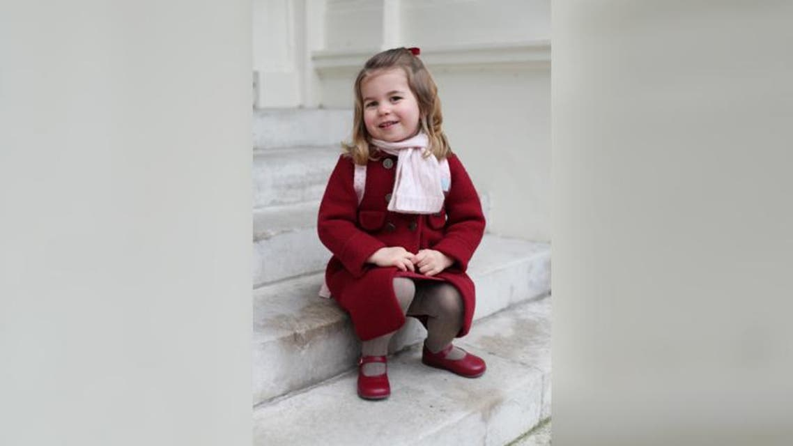 Britain's Princess Charlotte sits on the steps at Kensington Palace in a photograph taken taken by her mother Reuters