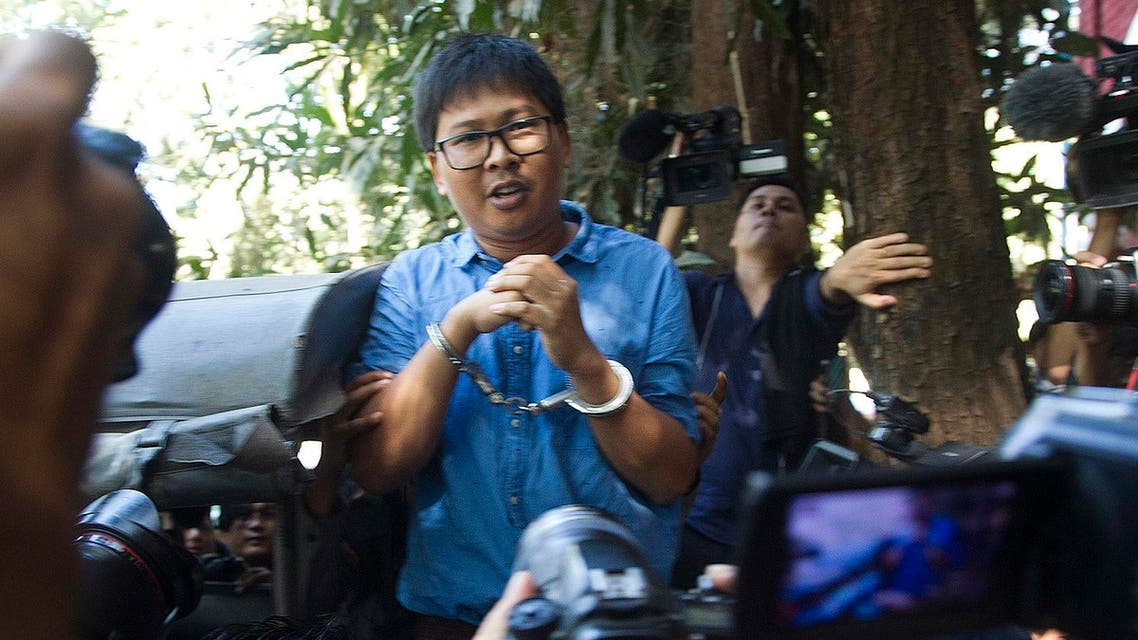 Reuters journalist Wa Lone speaks to media cuffed from the back of a police truck as he leaves court Wednesday, Jan.10, 2018, outside of Yangon, Myanmar. (AP)