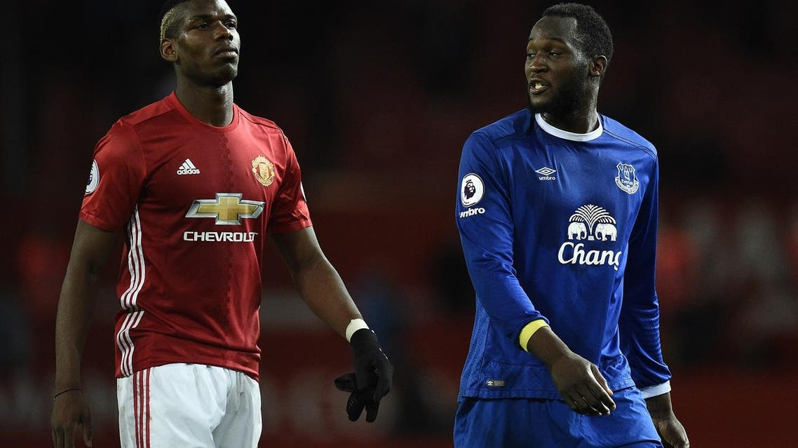Fle photo of Manchester United's French midfielder Paul Pogba (L) and Everton's Belgian striker Romelu Lukaku leave the pitch following the English Premier League football match on April 4, 2017. The match ended in a draw at 1-1. (AFP)