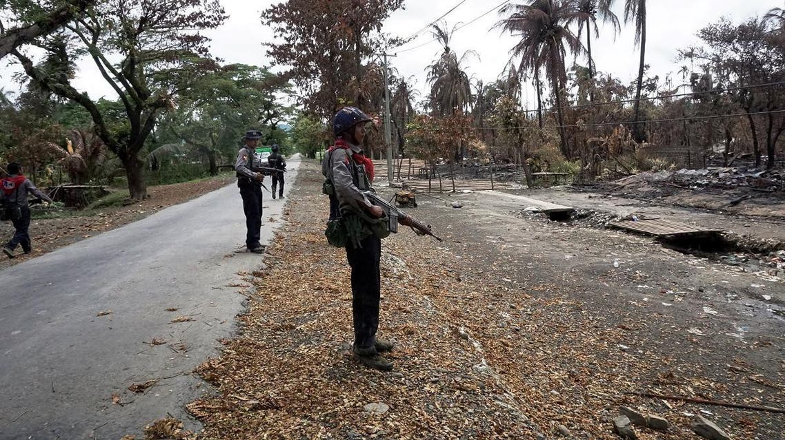 Myanmar policemen look at Myo Thu Gyi Muslim village where houses were burnt to the ground near Maungdaw town in northern Rakhine State. (AFP)