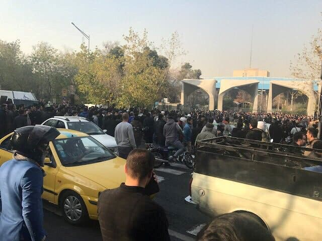 People protest near the university of Tehran on December 30, 2017 in this picture obtained from social media. (Reuters)