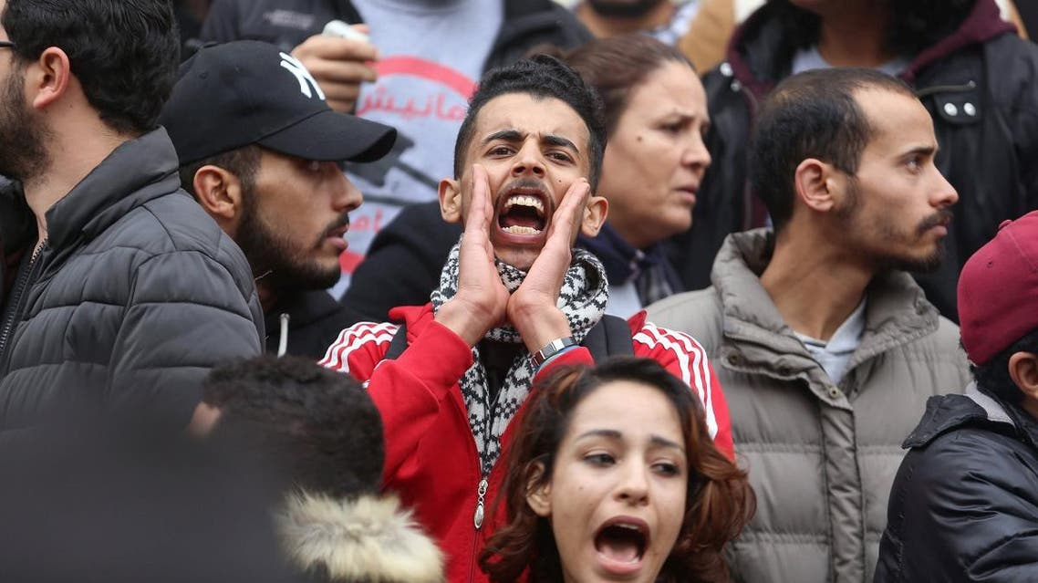 Demonstrating graduate shouts slogans during protests against rising prices and tax increases, in Tunis. (Reuters)