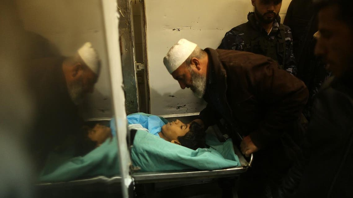 A relative mourns over the body of Palestinian teenager Amir Abu Musaid at the al-Aqsa hospital in Deir el-Balah, in the central Gaza Strip, after he was shot dead in clashes with the Israeli military along the Gaza border on January 11, 2018. (AFP)