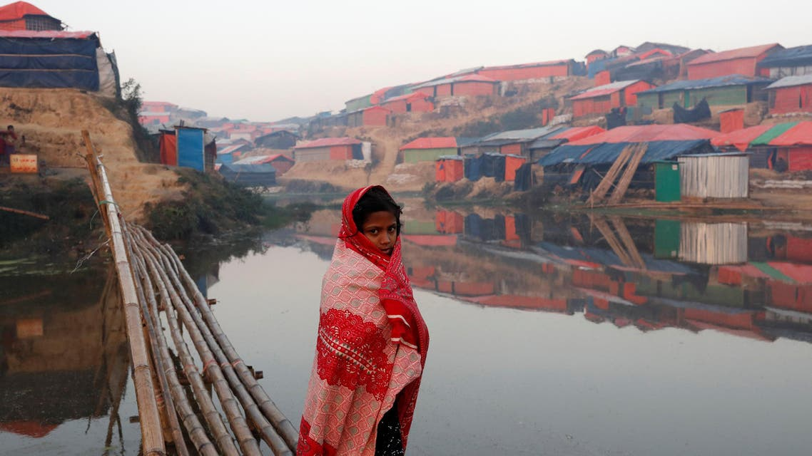 A Rohingya refugee girl walks next to a pond in the early morning at Balukhali refugee camp near Cox's Bazar, Bangladesh, on January 10, 2018. (Reuters)