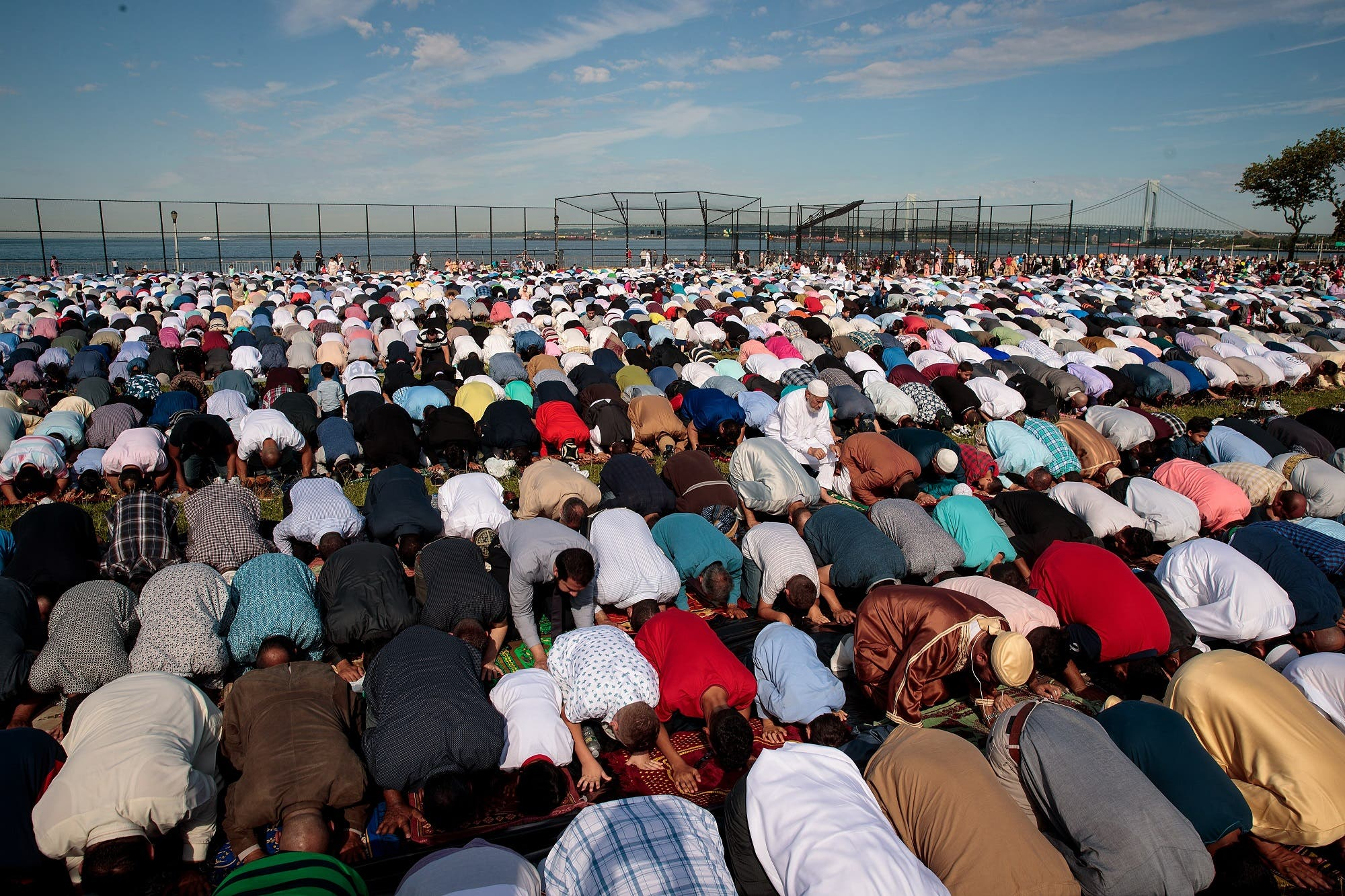 Muslims participate in a group prayer service during Eid al-Fitr in Bensonhurst Park in the Brooklyn borough on June 25, 2017 in New York City. (AFP)