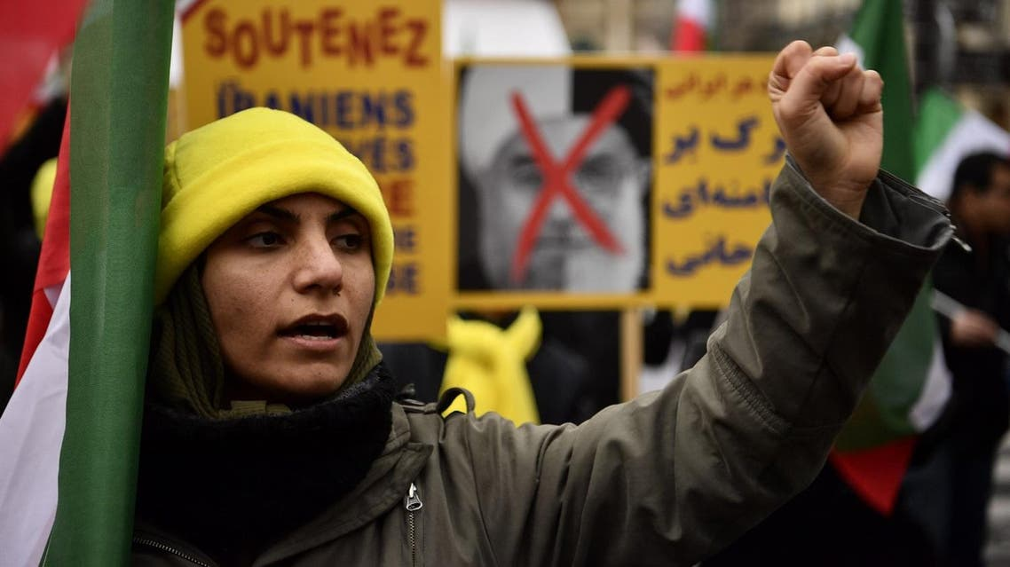 A protester raises her fist during a demonstration in support of the Iranian people amid a wave of protests spreading throughout Iran, on January 5, 2018, in Paris. (AFP)