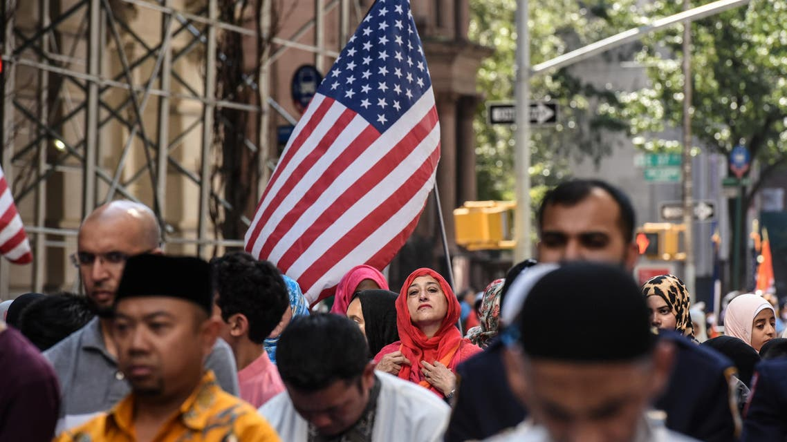 People participate in a group prayer in the street before the start of the annual Muslim Day Parade in New York City on September 24, 2017. (Reuters)