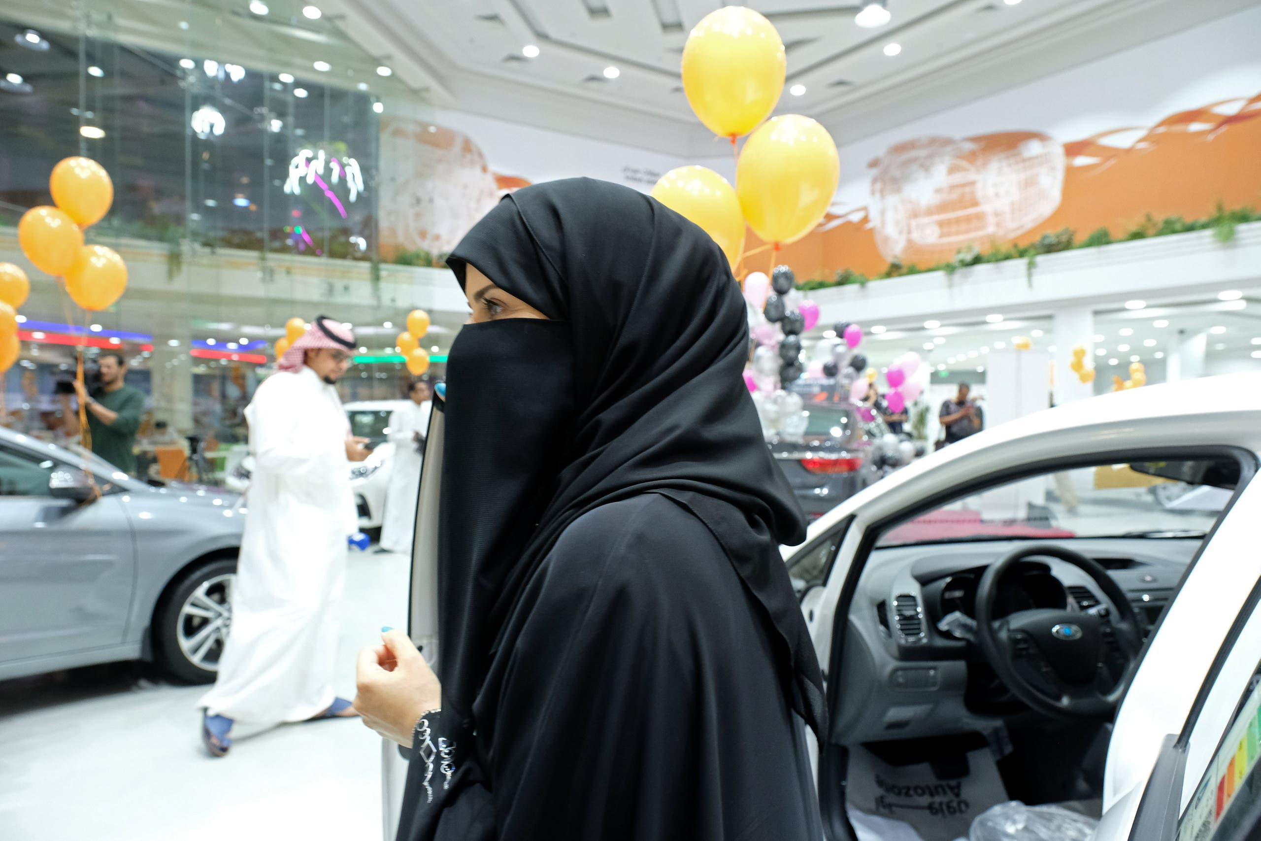 The exhibition focused on fuel-efficient cars and provided a team of saleswomen to help their new customer base. (Reuters)