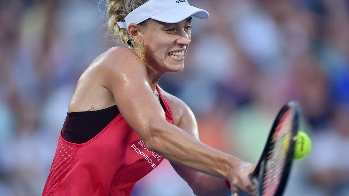 Angelique Kerber of Germany hits a return against Camila Giorgi of Italy during their women's singles semi-final at the Sydney International tennis tournament in Sydney on January 12, 2018. (AFP)