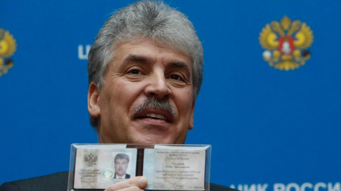 Businessman Pavel Grudinin, representing the Russian Communist Party, demonstrates his identity document after he was registered as a candidate in the upcoming presidential election the Central Election Commission headquarters in Moscow, Russia January 12, 2018. (Reuters)