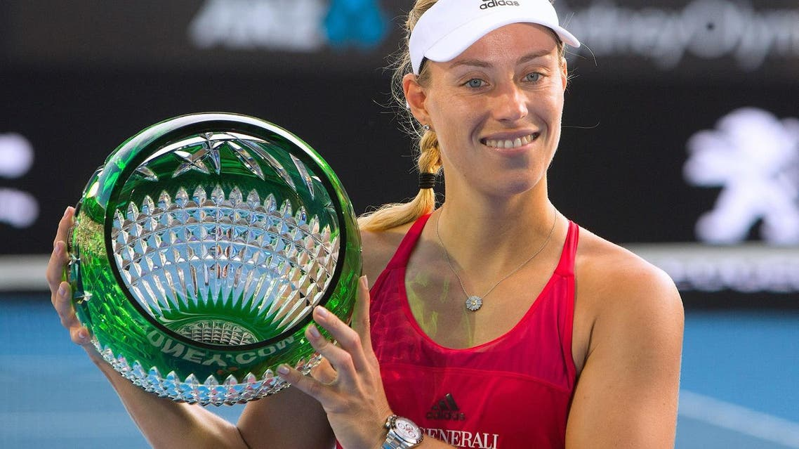 Germany's Angelique Kerber holds the trophy after winning the Women's final against Australia's Ashleigh Barty. (Reuters)