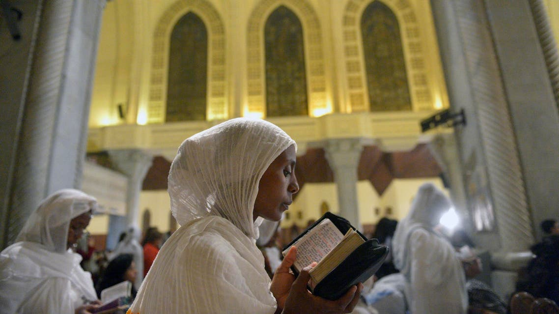 Ethiopian Christian Orthodox women attend an Easter mass at the Saint Mark's Cathedral, in Cairo's al-Abbassiya district on April 15, 2017. (AFP)
