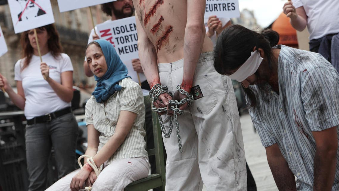 Reporters Without Borders activists take part in a protest in Paris, on July 10, 2012 to denounce journalists' imprisonment in Iran. (AFP)