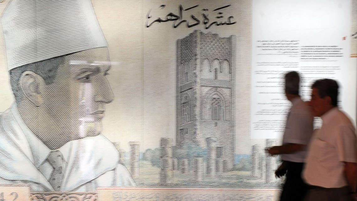 Visitors walk past a giant replica of a 10-dirham banknote dating back to the 1960s at the Numismatic Museum in Rabat on June 26, 2012. (AFP)