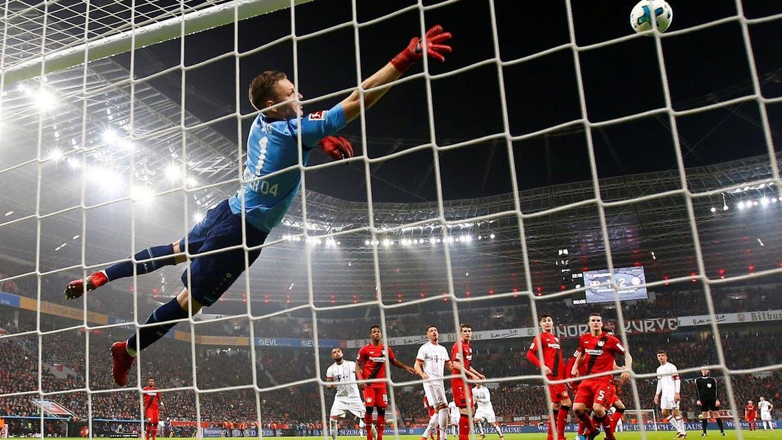 Bayern Munich's James Rodriguez scores their third goal as Bayer Leverkusen's Bernd Leno attempts to save. (Reuters)