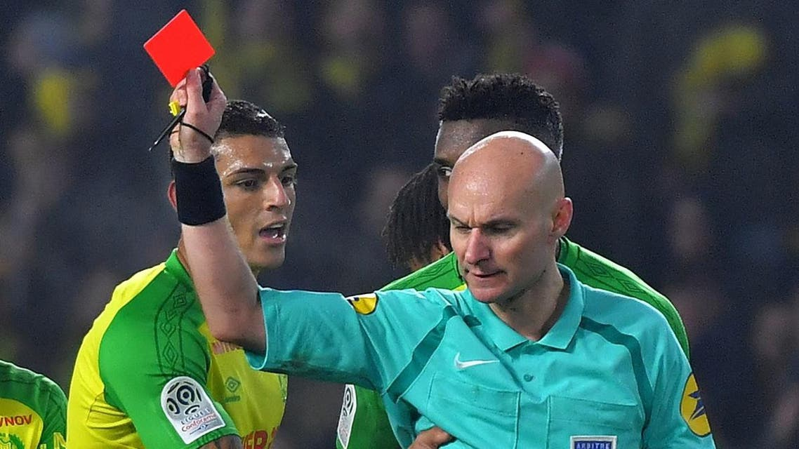 Nantes' Brazilian defender Diego Carlos (L) receives a red card from French referee Tony Chapron during the French L1 football match between Nantes and Paris Saint-Germain. (AFP)