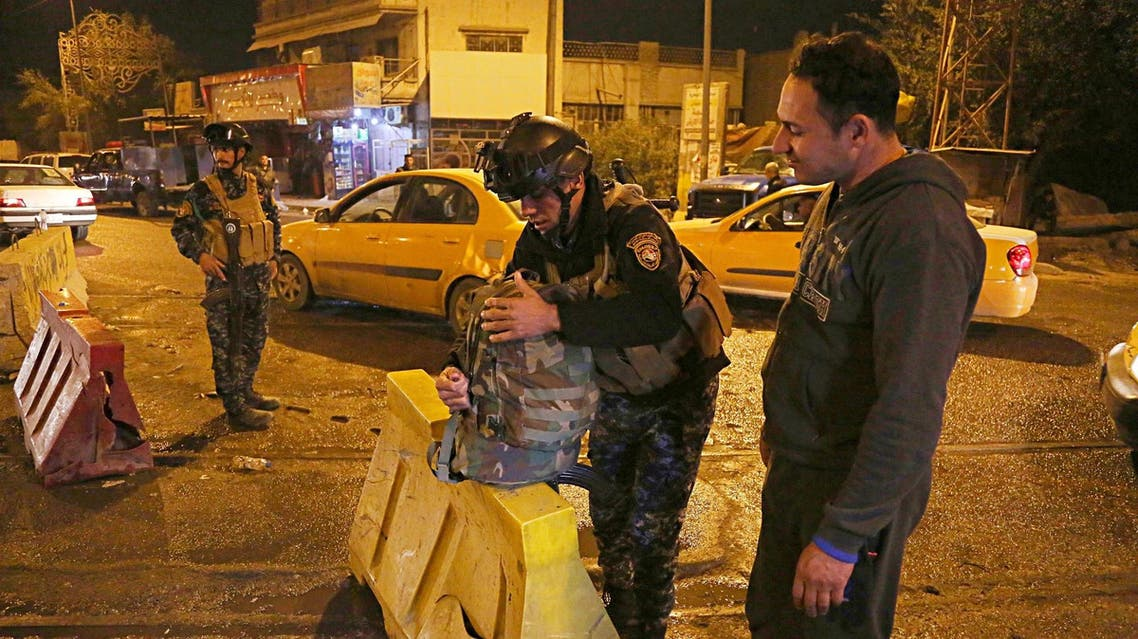 Iraqi security forces working at the scene of a suicide bombing in Baghdad on Jan. 13, 2018. (AP)