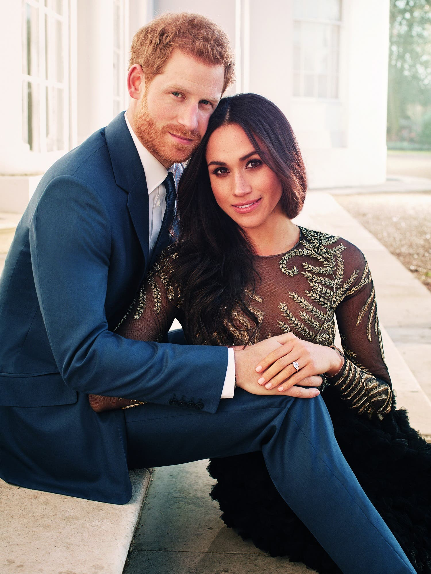 A handout picture released on December 21, 2017 by Kensington Palace shows Prince Harry posing with Meghan Markle at Frogmore House in Windsor. (AFP)