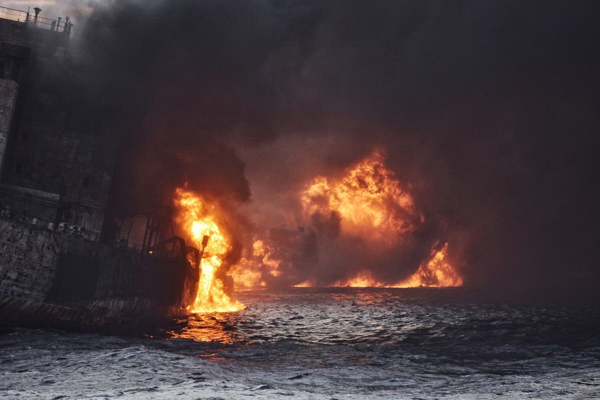 An Iranian oil tanker burst into flames from end to end and sank on January 14, eight days after it caught fire following a collision with a cargo ship off China. (AFP)