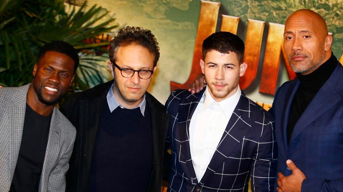 US Director Jake Kasdan, second left, poses with Jumanji actors, Kevin Hart, Nick Jonas and Dwayne Johnson. (AP)