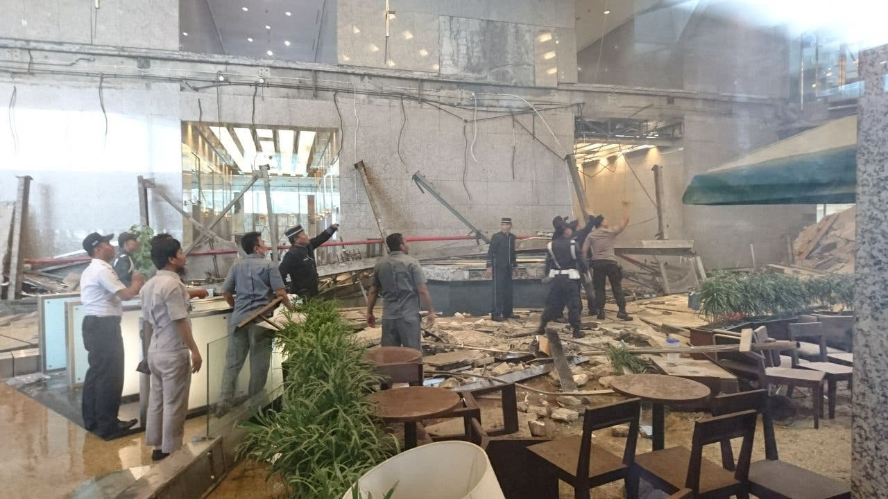 Workers and security examine the damage after a mezzanine floor collapsed at the Indonesia Stock Exchange building in Jakarta. (Reuters)