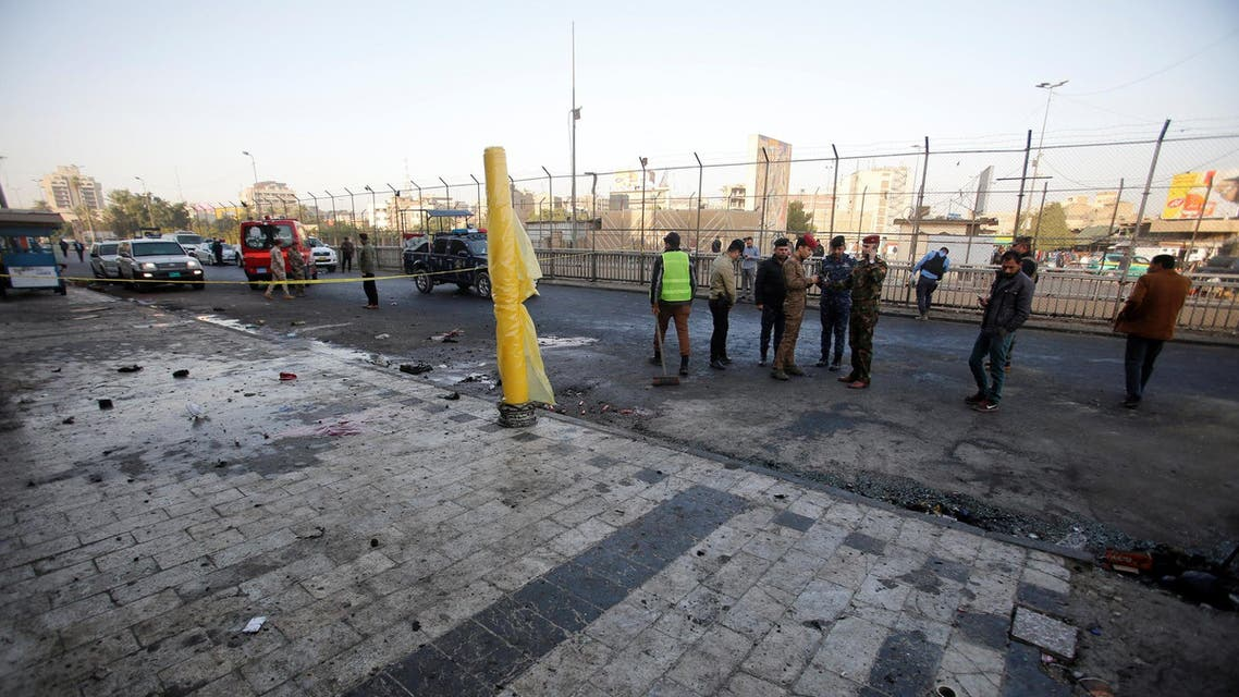 Iraqi security forces inspect the site of a bomb attack in Baghdad on January 15, 2018. (Reuters)
