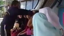 VIDEO: Outrage over Malaysian slapping woman for not wearing hijab