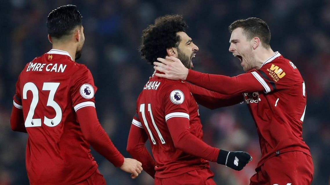 Liverpool's Mohamed Salah celebrates with Andrew Robertson after scoring their fourth goal. (Reuters)
