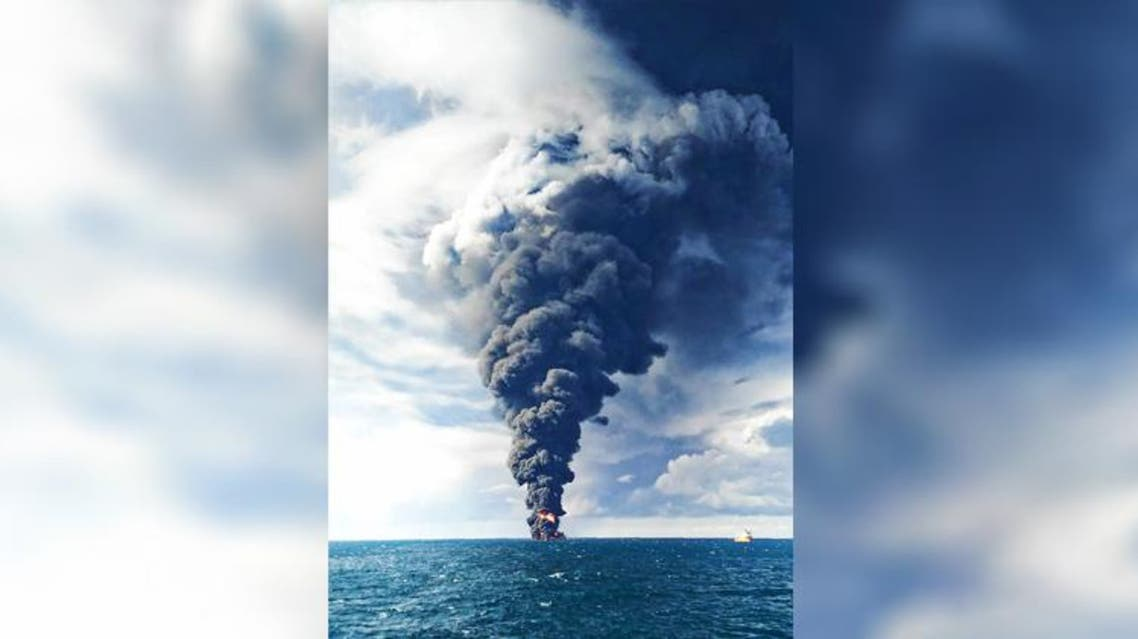 Smokes and flames engulf the burning Iranian oil tanker Sanchi in the East China Sea. (AP)