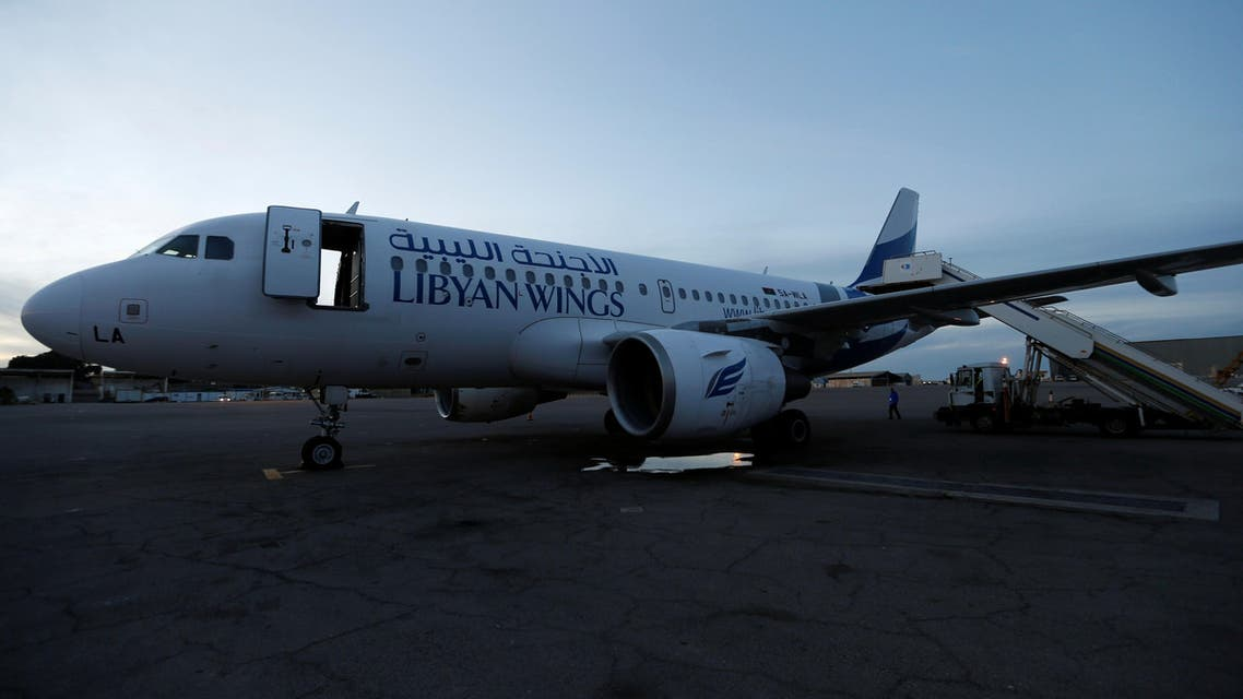 A plane, that was damaged during clashes, is seen at Mitiga airport in Tripoli on January 15, 2018. (Reuters)
