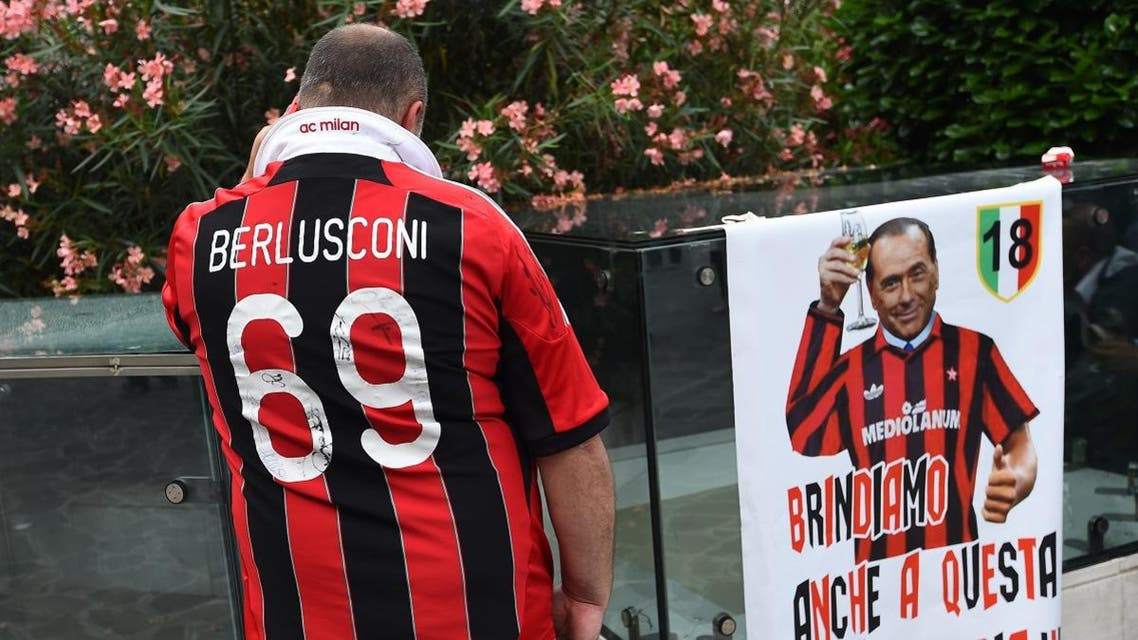 A supporter of the AC Milan football club wears a jersey of the honorary president of the club Silvio Berlusconi. (AFP)