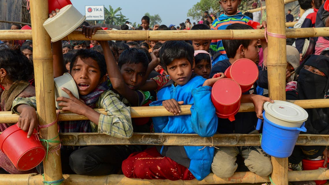 Rohingya Muslim refugees wait for food aid at Thankhali refugee camp in Bangladesh's Ukhia district on January 12, 2018. (AFP)