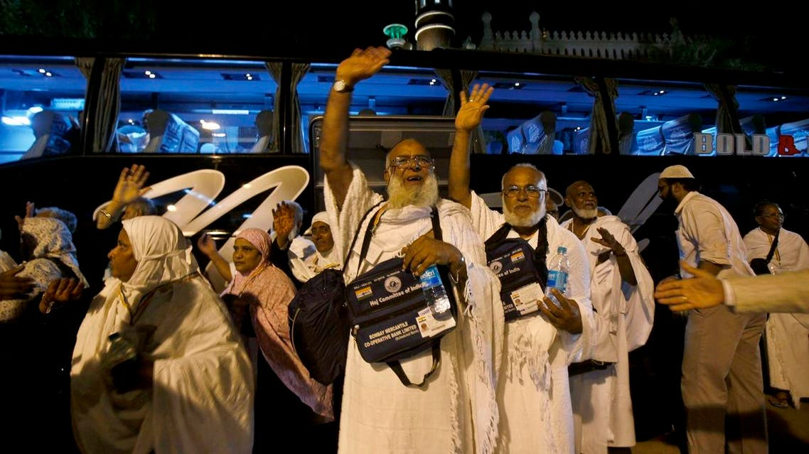 Indian Muslim Hajj pilgrims wave to their relatives before boarding a bus as they leave for an annual pilgrimage to Mecca. (AP)