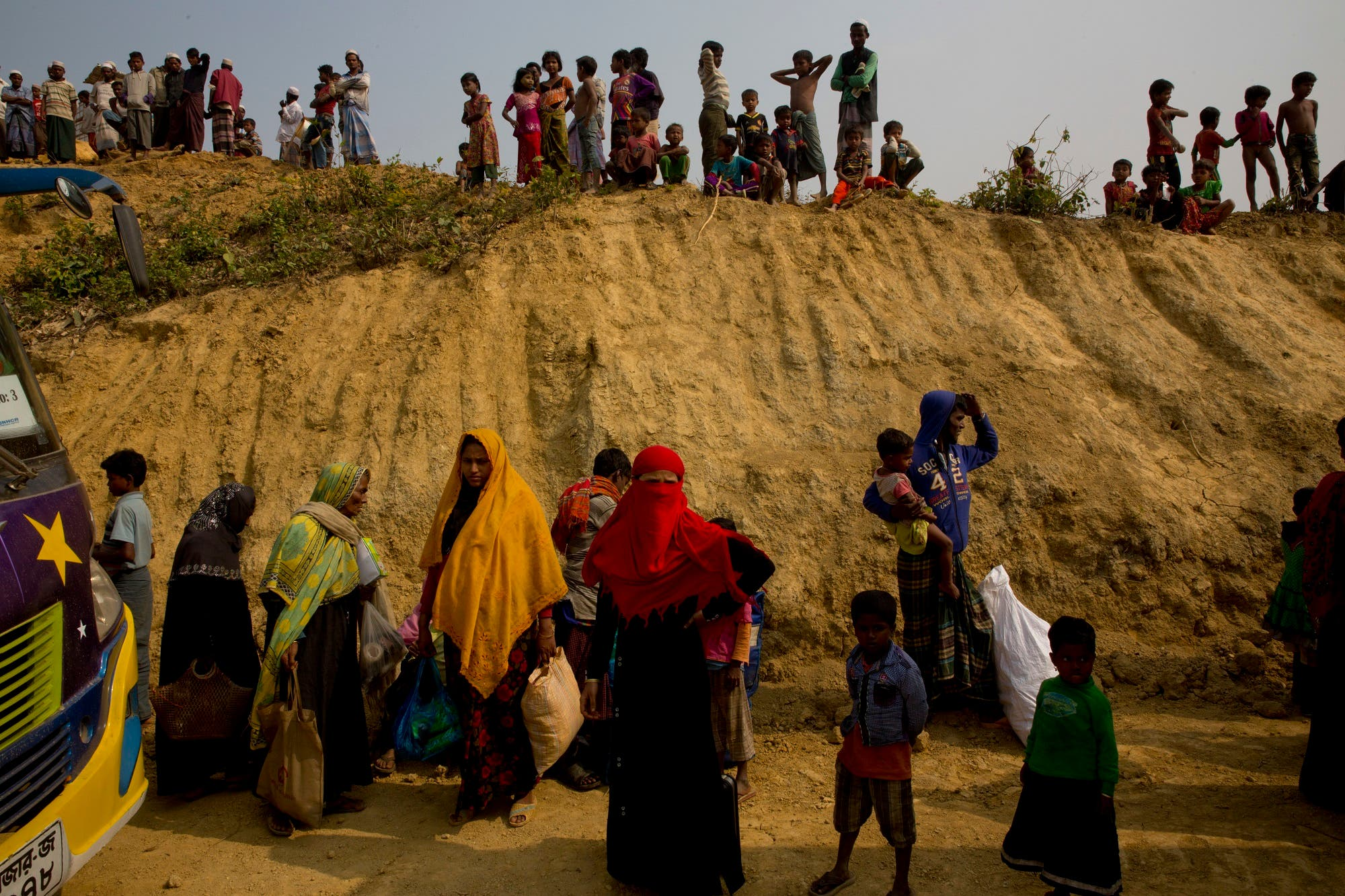 Rohingya Muslims watch from atop a hill as new refugees arrive in Balukhali refugee camp, 50 km from Cox's Bazar, Bangladesh, on Jan. 14, 2018. (AP)