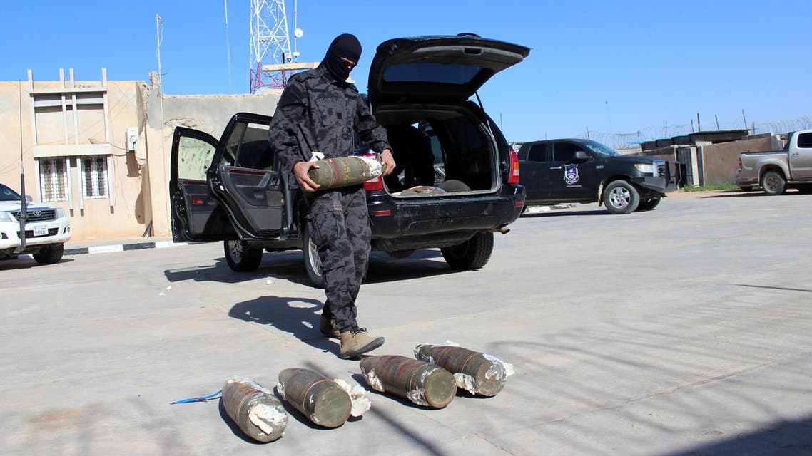 A security member of Misrata counter-terrorism removes explosives from a car driven by a suspected ISIS militant on January 11, 2018. (Reuters)