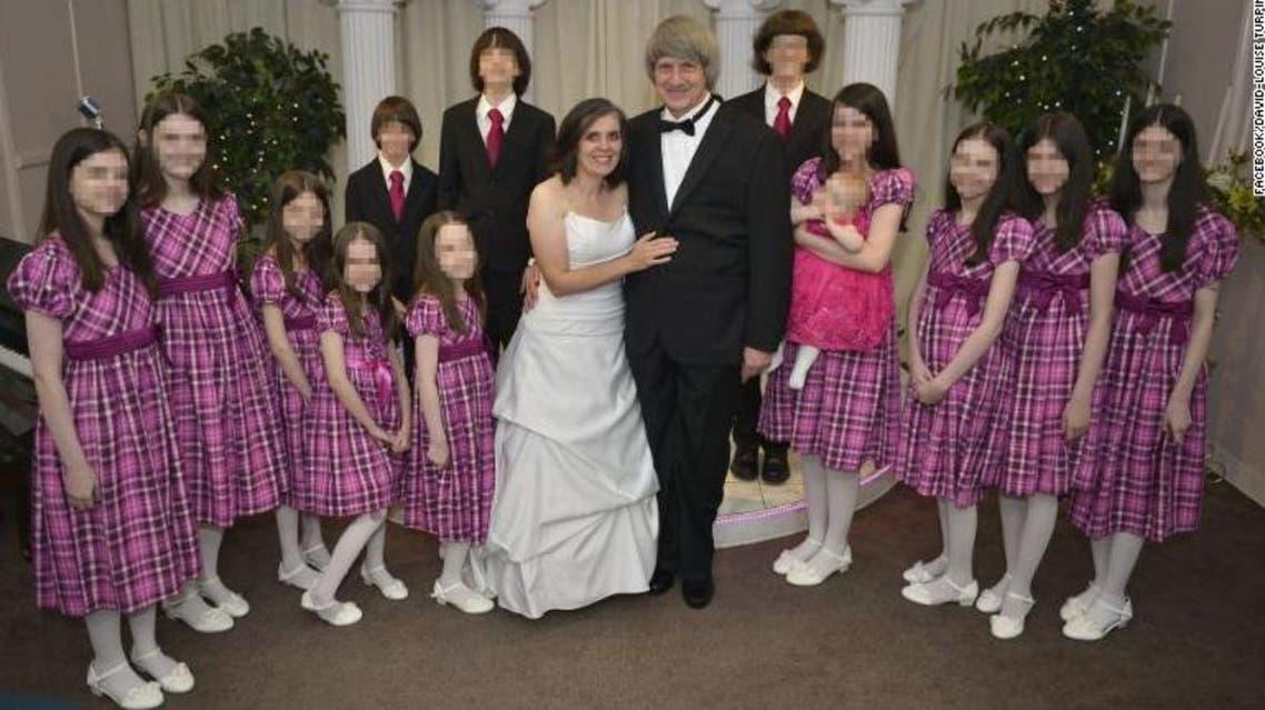الزوجان مع أطفالهما