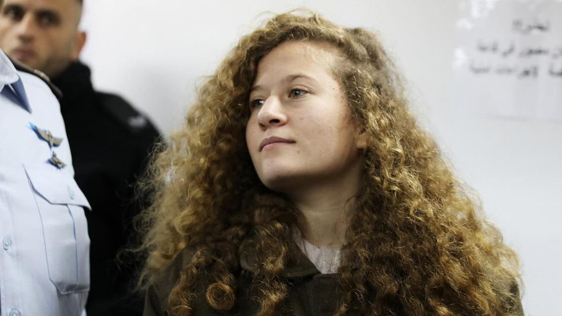 Palestinian teen Ahed Tamimi enters a military courtroom at Ofer Prison, near the West Bank city of Ramallah. (Reuters)