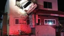 WATCH: Car flies off road, crashes in top floor of building in California