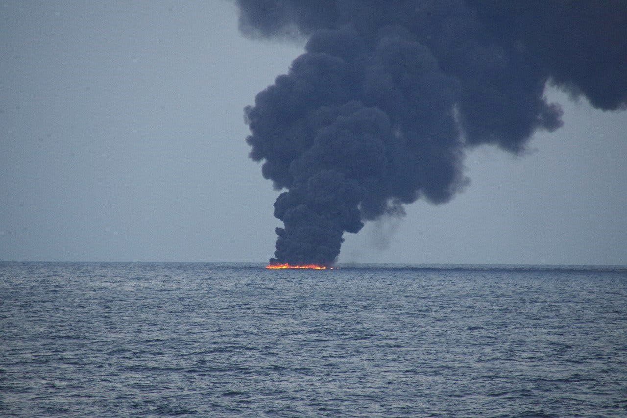 Flames and smoke from the Iranian oil tanker Sanchi is seen in the East China Sea, on January 15, 2018. (Reuters)