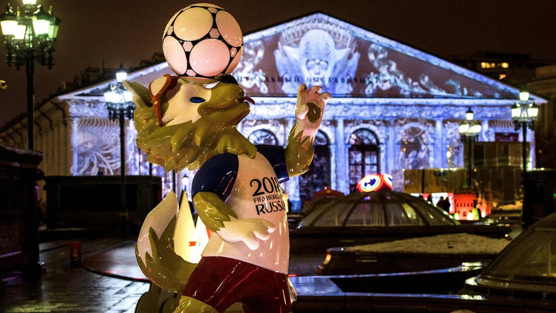 A photograph taken on December 11, 2017 shows the FIFA World Cup 2018 mascot Zabivaka in front of the Manege Exhibition Hall outside the Kremlin in Moscow. Images are projected on the facade of the Manege marking the Year of Ecology and the upcoming holdays. Mladen ANTONOV / AFP