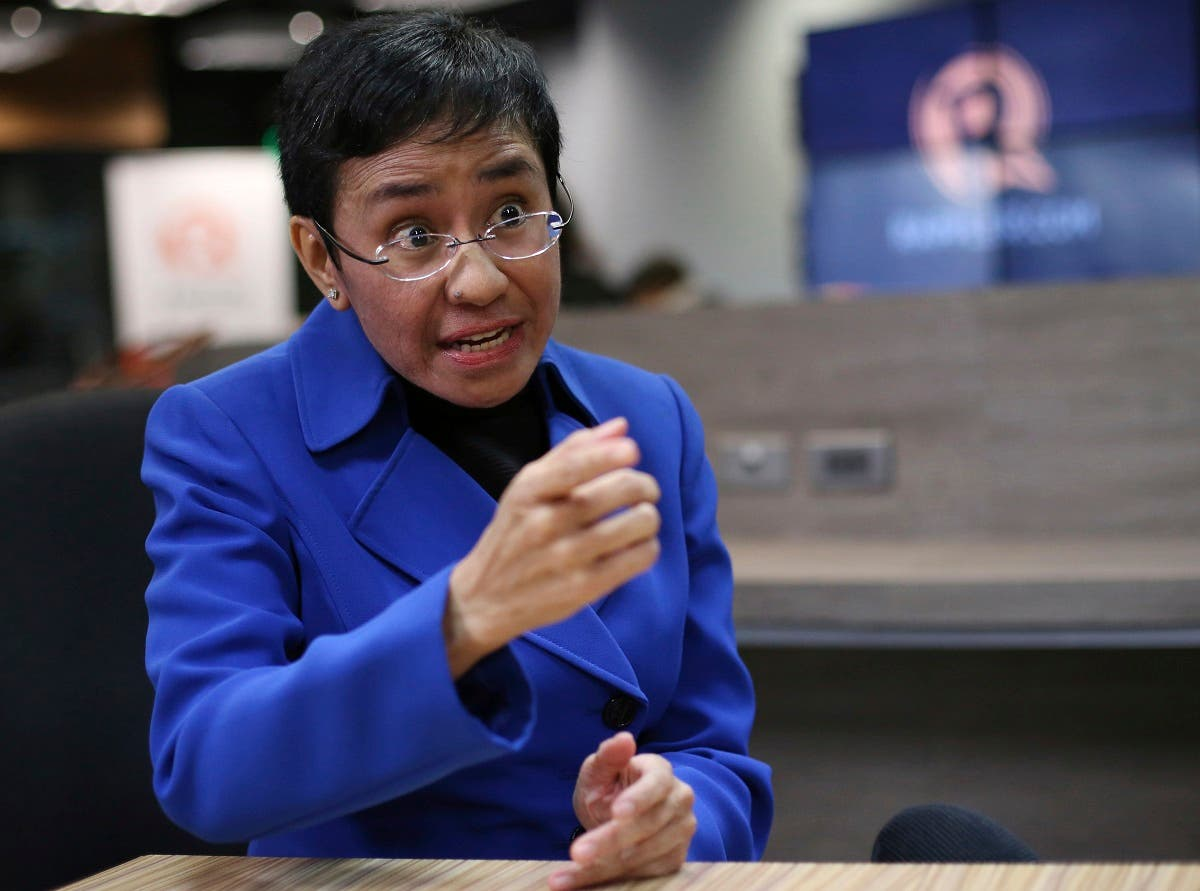 Rappler CEO and Executive Editor Maria Ressa gestures during an interview at their office in metropolitan Manila. (AP)