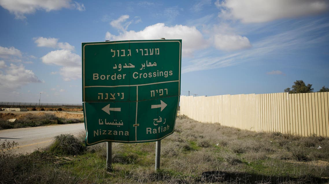 Road sign pointing to the directions of border crossings, positioned next to the entrance of the Kerem Shalom border crossing terminal, Israel January 16, 2018. REUTERS/Amir Cohen