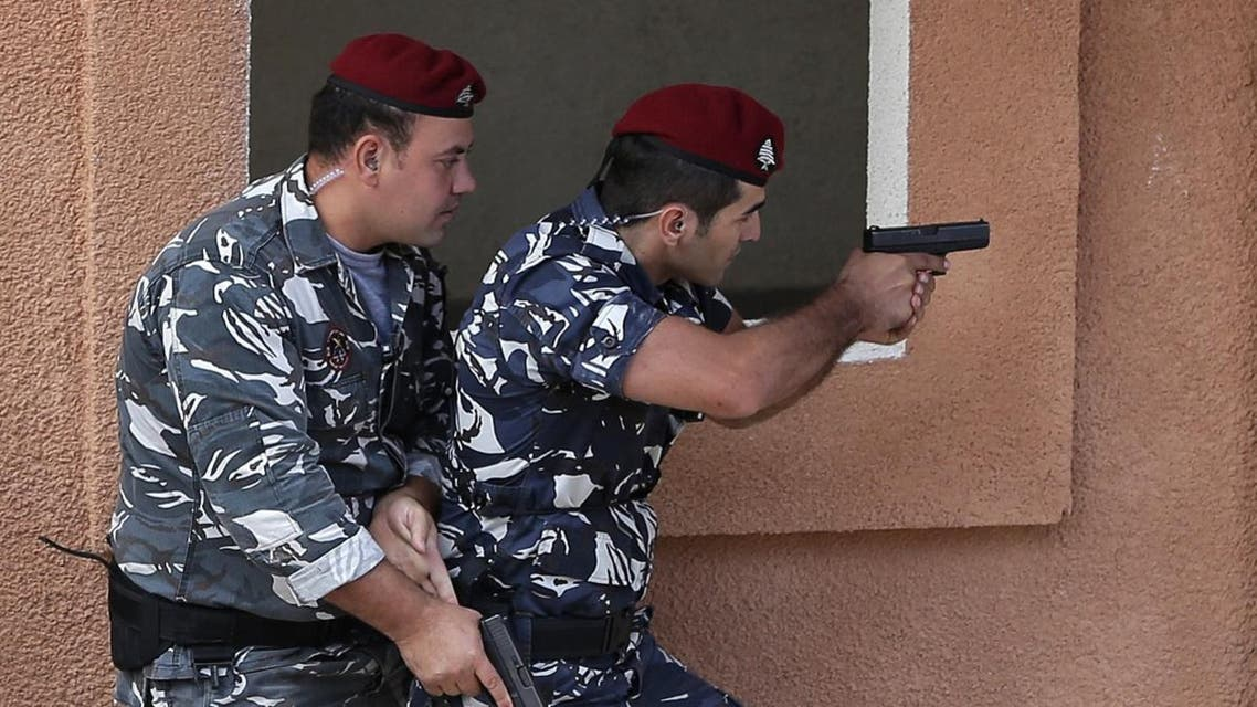 Lebanese Internal Security Forces (ISF) demonstrate their skills at the forces simulation training village during their inauguration ceremony in the town of Aramoun. (AFP)