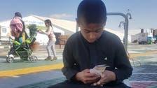 شاهد.. طفل سعودي تاجر بمهرجان الزيتون في سكاكا