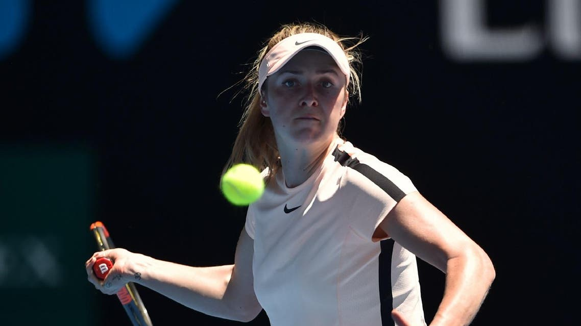 Elina Svitolina hits a return against compatriot Marta Kostyuk on day five of the Australian Open in Melbourne on January 19, 2018. (AFP)